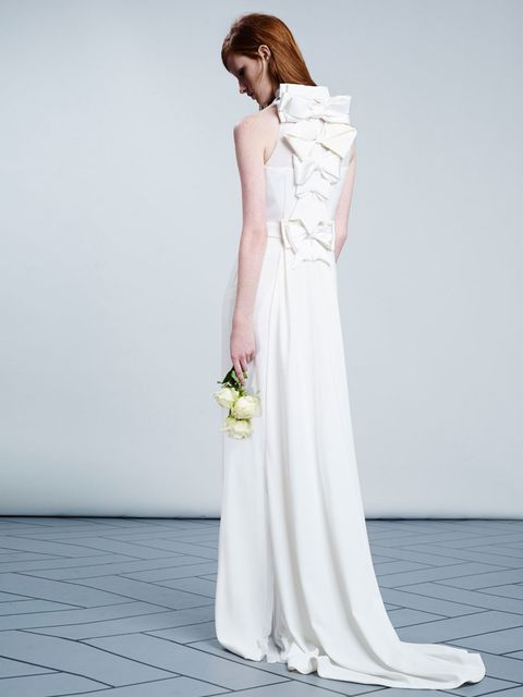<p><strong>They say:</strong> 'A long stretch crepe dress with bow-back detailing in crepe, satin, transparent chiffon with a pleated insert.'</p><p><strong>We say:</strong> 'We love that the pile-up of bows is imperfect; it makes this look adorably roman