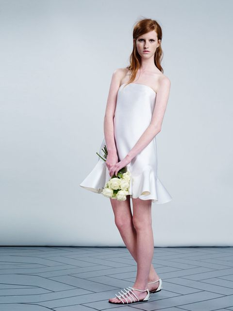 <p><strong>They say: </strong>'A strapless, white/ivory knee-length trapeze silhouette with evening coating and volant detail.'</p><p><strong>We say:</strong> 'This is the perfect alternative to a full-skirted 50s style if you want to opt for mini.' </p><