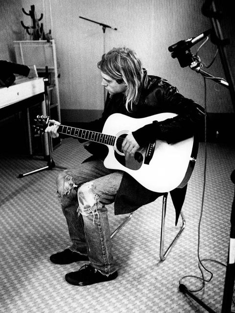 <p><strong>Kurt Cobain, 1991</strong></p><p>Ripped denim accessorised with a guitar. Be still our beating hearts.</p>