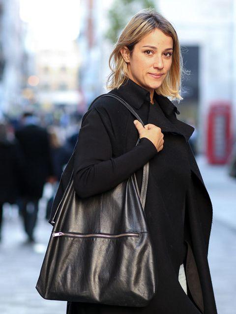 <p>Delphine Gaultier</p>  <p>Nicole Farhi coat, Cos bag.</p>