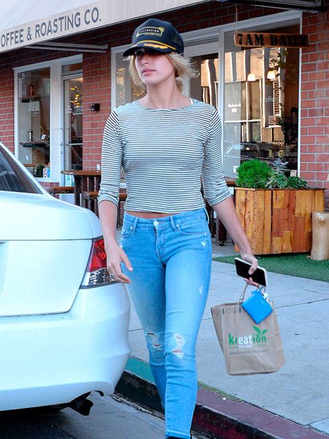 <p>Hailey looking casual with cute heeled black boots in L.A August 2015.</p>