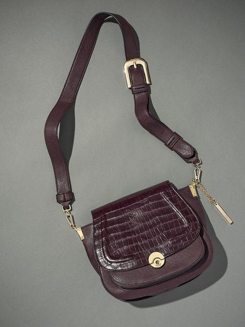 """<p><a href=""""http://www.dunelondon.com/delphine-contrast-foldover-panel-saddle-bag-0022500110069530/?utm_source=Elle-Magazine&utm_medium=Gallery&utm_content=Delphine-Berry&utm_campaign=Elle-360"""">Delphine</a>-£59</p>"""