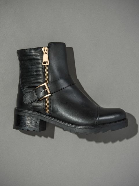 """<p><a href=""""http://www.dunelondon.com/poloma-shark-sole-quilted-leather-biker-boot-0092508770002484/?utm_source=Elle-Magazine&utm_medium=Gallery&utm_content=Poloma-Black&utm_campaign=Elle-360"""">Poloma</a>-£115</p>"""