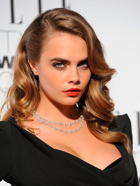 """<p><a href=""""http://www.elleuk.com/fashion/celebrity-style/cara-delevingne-s-style-file"""">Cara</a> goes for retro waves and a classic red lip on the ELLE Style Award red carpet tonight.</p>"""