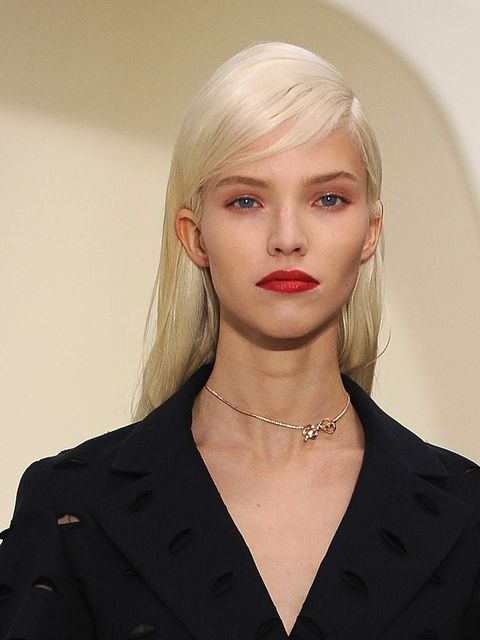 """<p>The rule that pink and red clash? Forget it. Dior's pairing of pastel pink eye shadow with a bold red lip may not be conventional, but we love it.</p><p><a href=""""http://www.elleuk.com/catwalk/designer-a-z/christian-dior/couture-ss-2014"""">Click here to s"""