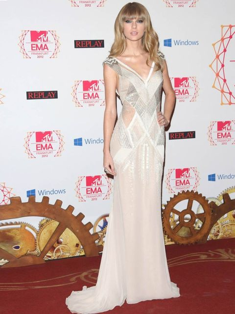 <p>Taylor Swift in a beaded J. Mendel gown Christian Louboutin shoes and Neil Lane jewellery</p>