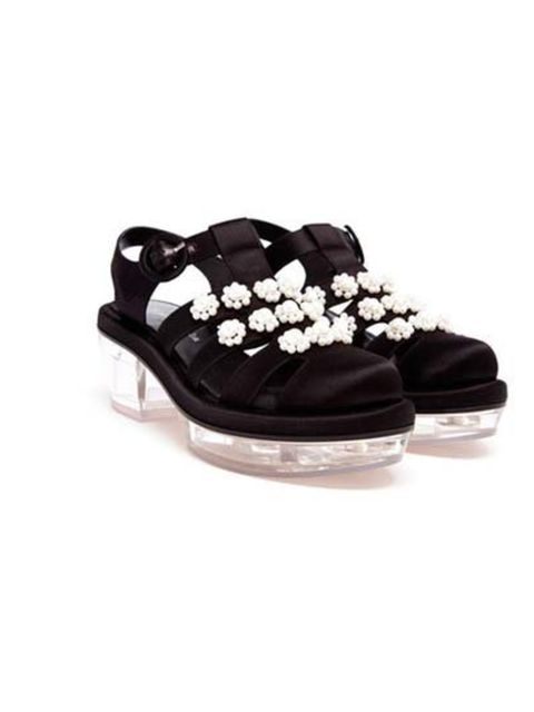 """<p>Perspex and satin sandals with Simone's floral pearl embellishment, are £915 at <a href=""""http://www.brownsfashion.com/product/038S52740003/027/pearl-embellished-satin-sandals"""">Browns</a>.</p>"""