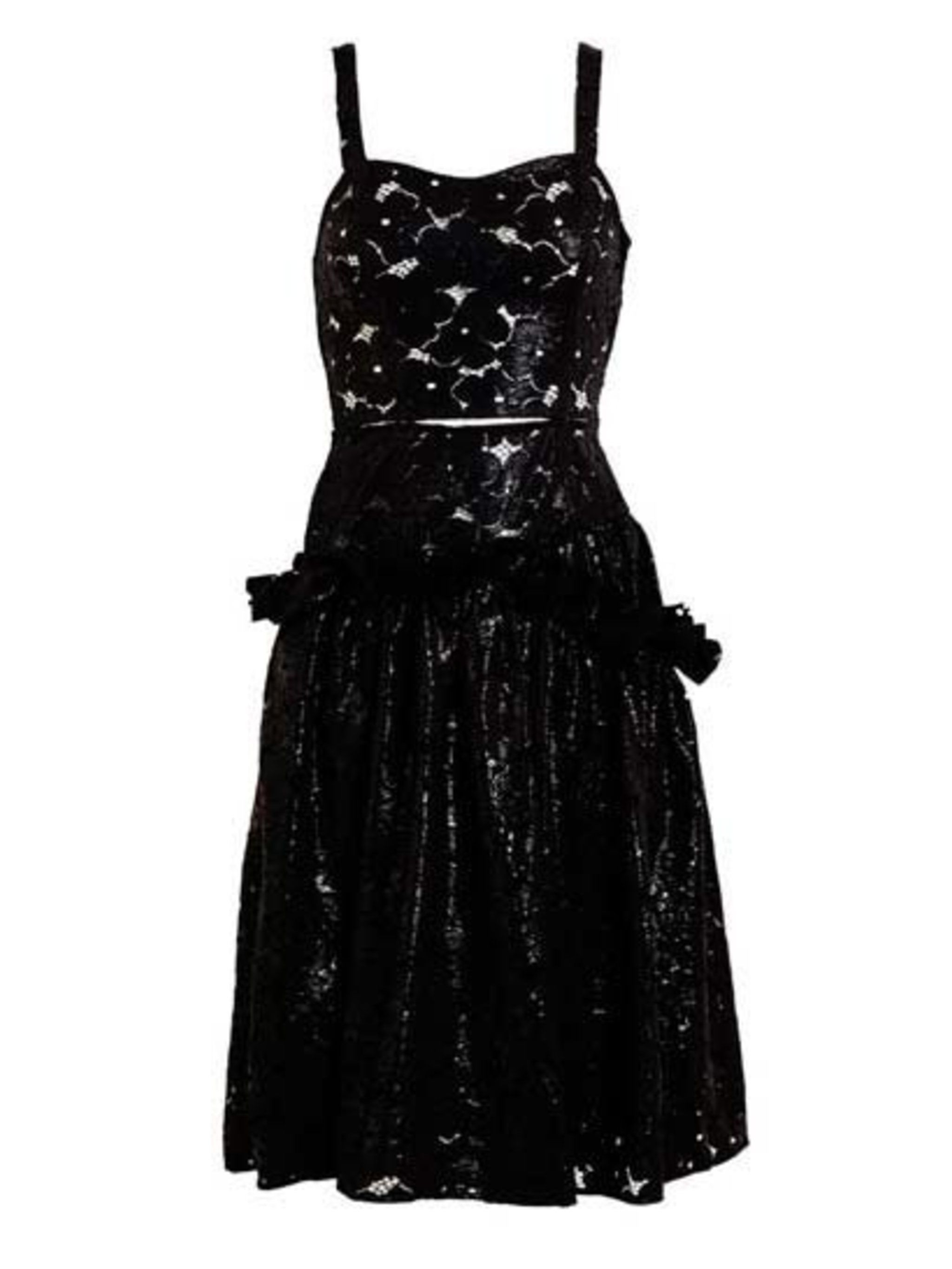 "<p>Boned black floral lace dress with wet-look coating, and a defined waist with cut-out detailing. This showpiece dress is £1,260 at <a href=""http://www.brownsfashion.com/product/038S09740007/027/wet-floral-lace-dress"">Browns</a>.</p>"
