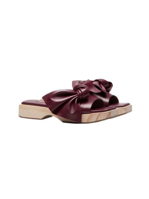 """<p>A statement sandal will breathe new life into a tried-and-tested summer wardrobe of blue jeans and white t-shirts.</p><p><a href=""""http://www.uterque.com/gb/en/new-in-store/wooden-sandals-with-bow-c96511p5659003.html?color=021"""" target=""""_blank"""">Uterqüe"""