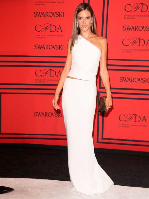 <p>Alessandra Ambrosio wears a white asymmetric Kaufmanfranco dress.</p>