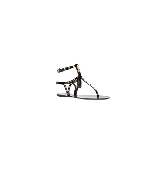 "<p>Give your look an edge with studded sandals, Ioannis flats, £129.90, at <a href=""http://www.farfetch.com/shopping/women/ioannis-studded-t-bar-sandal-item-10422981.aspx?storeid=9339"">Farfetch.com</a></p>"