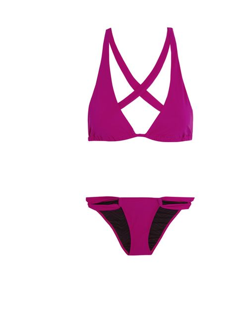 "<p>The ultimate holiday staple. Every girl, of course, needs a decent bikini. Try this cross-back halterneck by Matthew Zink.</p><p>Paulina bikini, £175, by Charlie by Matthew Zink, <a href=""http://www.net-a-porter.com/product/380157"">Net-a-Porter</a></p>"