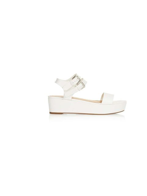 """<p>The flatform sandal has turned out to be the shoe of the summer - we love this minimalist white pair.</p><p><a href=""""http://www.topshop.com/en/tsuk/product/shoes-430/flats-459/hanna-flatform-sandals-1841081?bi=1&ps=200"""">Topshop</a> shoes, £32</p>"""