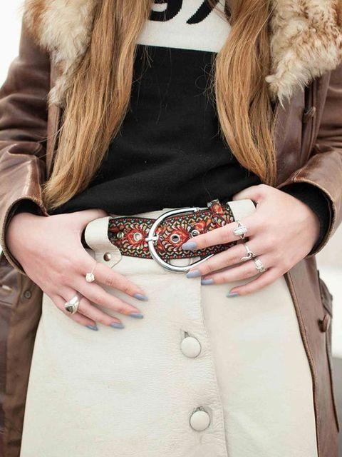 Rafi wears a vintage coat and skirt, Bella Freud jumper, Zara boots and Topshop belt