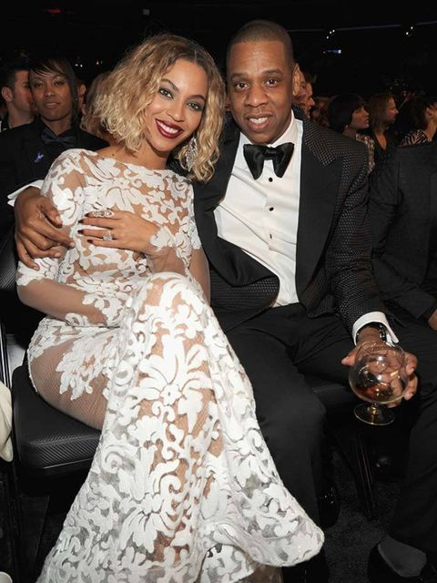 "<p>Jay Z and <a href=""http://www.elleuk.com/star-style/celebrity-style-files/beyonce"">Beyoncé</a>, wearing a Michael Costello dress, post-performance at the 56th Annual Grammy Awards.</p>"