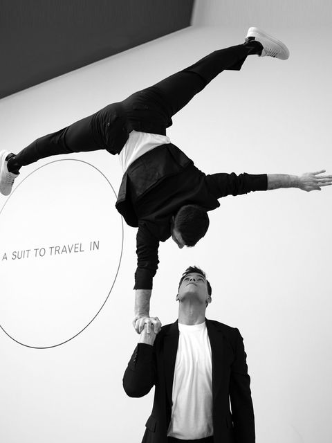 <p>How to best demonstrate the versatility of Paul Smith's new suit line? Put it on gymnasts and get them to show off their skills, of course.</p>