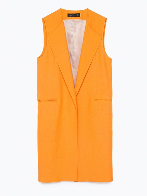 "<p><a href=""http://www.zara.com/uk/en/woman/jackets/view-all/long-waistcoat-c719017p2649523.html"" target=""_blank"">Zara</a> yellow sleeveless jacket, £69.99</p>"