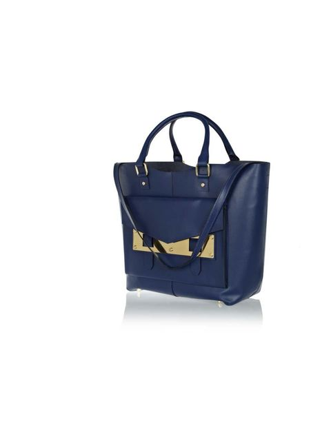 """<p>River Island is my go-to for statement pieces that channel the key new season trends.</p><p>- Sarah Bonser, Fashion Assistant</p><p><a href=""""http://www.riverisland.com/women/bags--purses/shopper--tote-bags/Blue-leather-metal-plate-tote-bag-638220"""">Rive"""