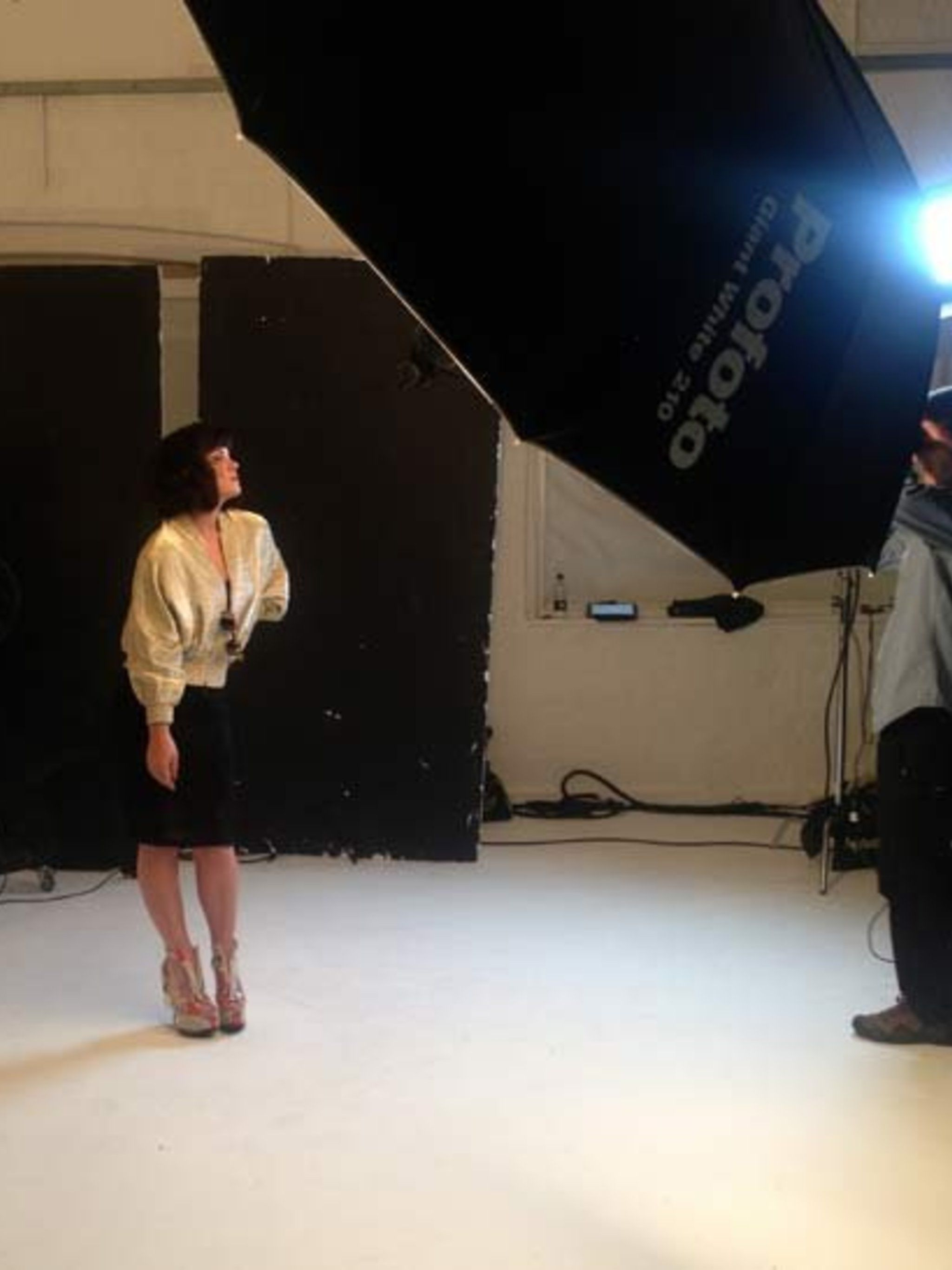 <p>Lily strikes a pose in a gold Vionnet bomber jacket.</p>
