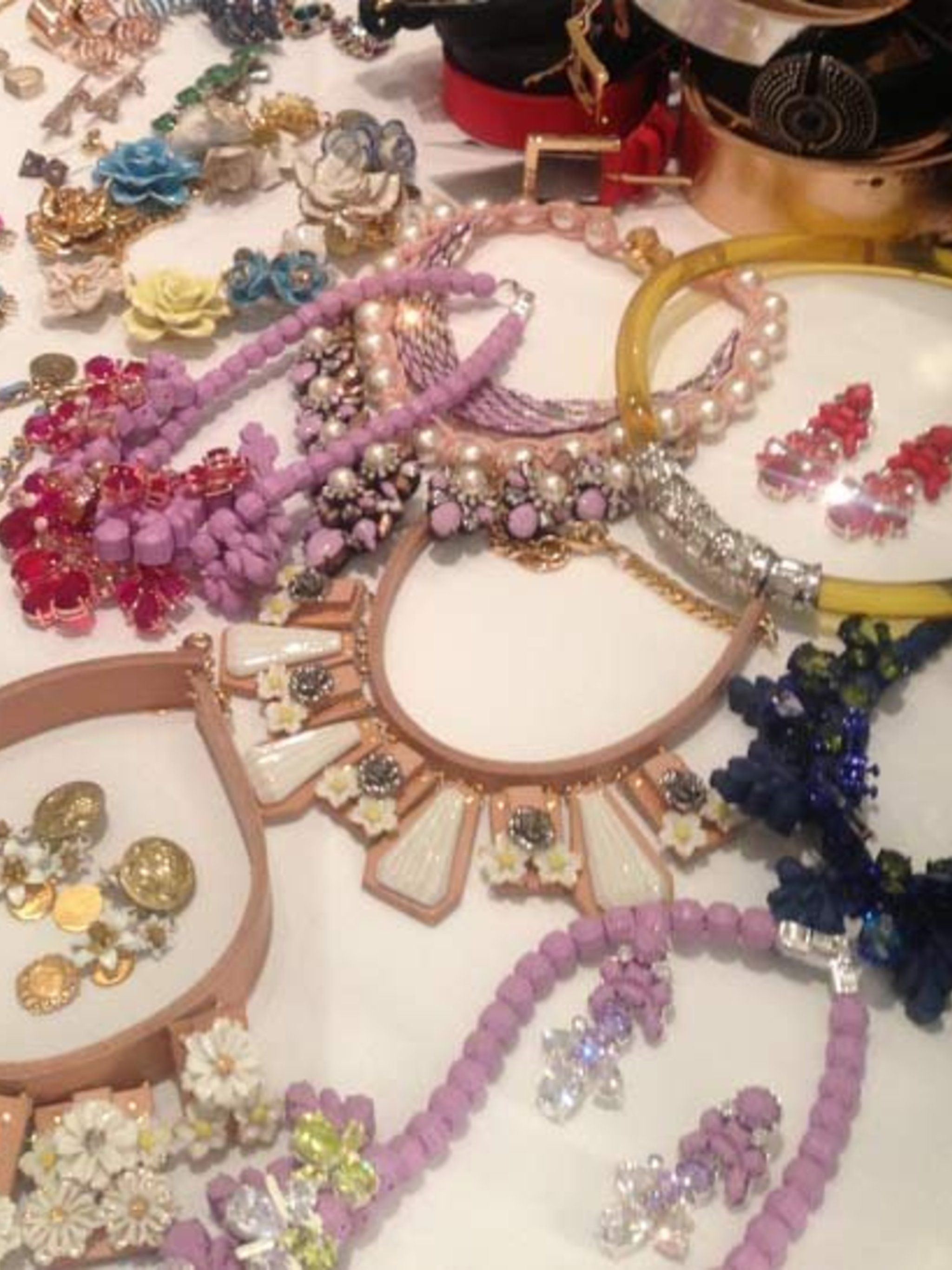 <p>Brightly coloured rubber and ceramic necklaces on set.</p>