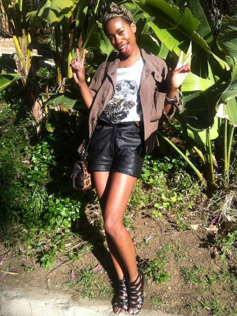 <p>Tolula Adeyemi wears an All Saints smock top and tee with leather shorts at Coachella.</p>