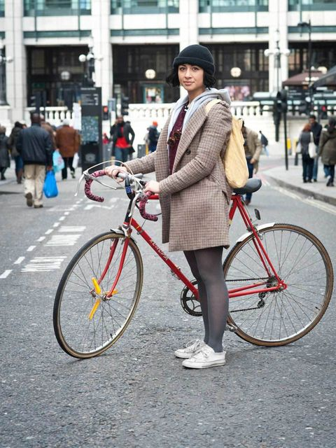 <p>Ella, 22, Creative. Europa bike, Zara coat and shorts, American Apparel hoody, Urban Outfitters jumper, customised Converse trainers, charity shop hat and glasses.</p><p>Photo by Stephanie Sian Smith</p>