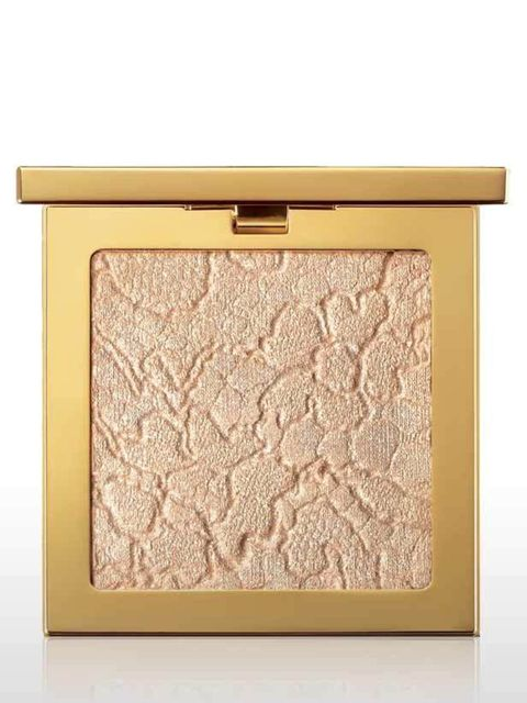<p>This soft golden, special edition powder is housed in a luxurious, and heavy, gold compact. The golden hue lightens skin instantly and is a wonderful skin fix on dull days. The perfect winter pick-me-up.</p><p>Gold Attraction Face Palette, £35 by <a hr