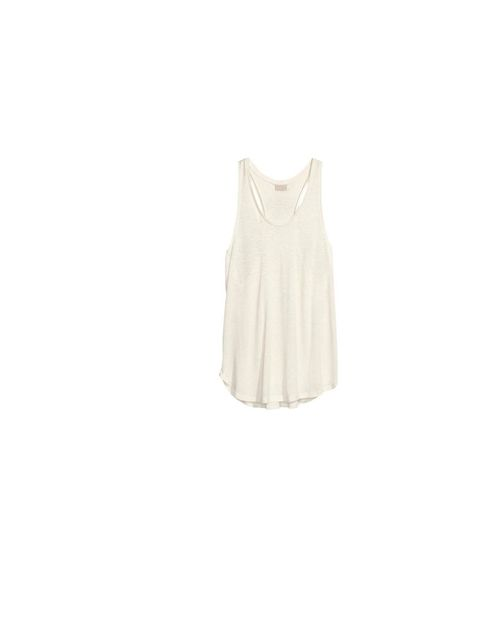 "<p>A cami is key to transeasonal layering, <a href=""http://www.hm.com/gb/product/17414?article=17414-B"">H&M</a> vest, £9.99</p>"