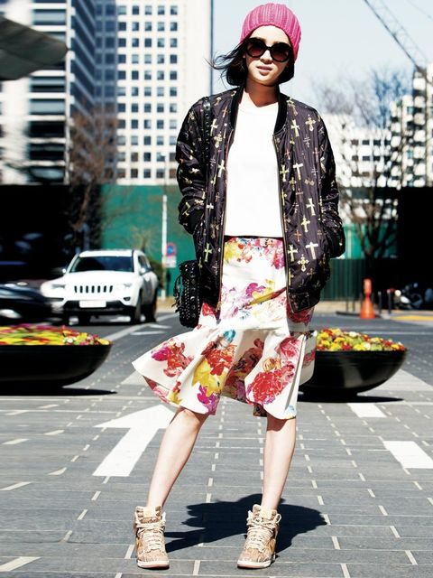 <p>A floral skirt makes this sporty bomber jacket and high-tops look instantly girly, Korea. </p>