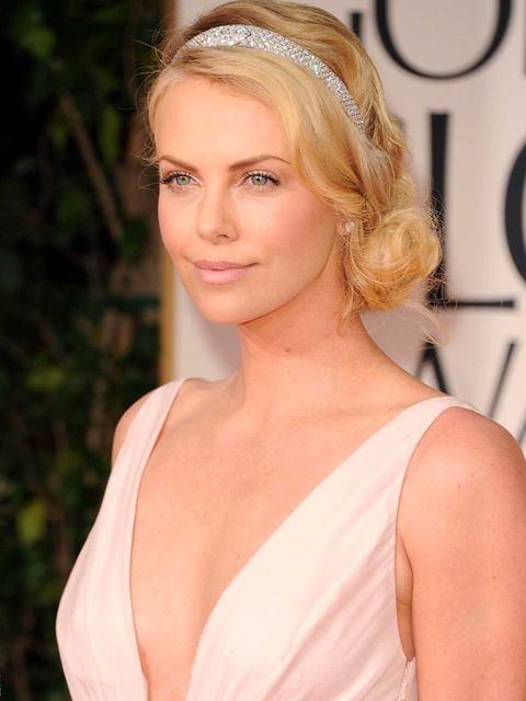 <p>Charlize Theron romantic up-do at the Golden Globes 2012</p>