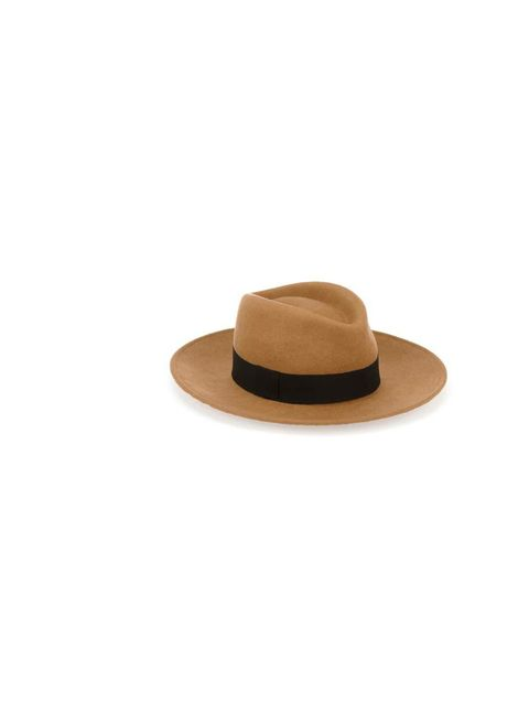 <p>A sudden cold snap this week sent the ELLE staffers running for their opaque tights and chunky knits. But grey days needn't mean grey outfits - keep the cold at bay by mixing textures, prints and off-beat accessories. </p><p>An androgynous felt fedora