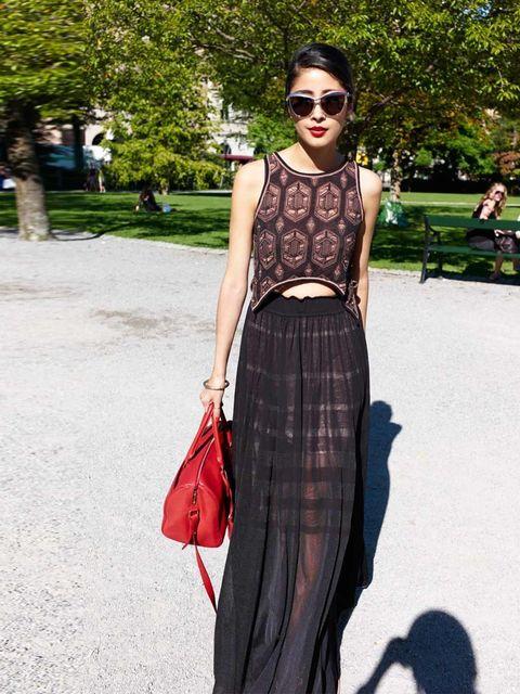 """<p>Denni Elias is wearing <a href=""""http://www.elleuk.com/fashion/designers-to-know/dagmar"""">Dagmar</a> dress, with <a href=""""http://www.elleuk.com/catwalk/designer-a-z/saint-laurent/autumn-winter-2013"""">Saint Laurent</a> bag.</p><p>More street style inspirat"""