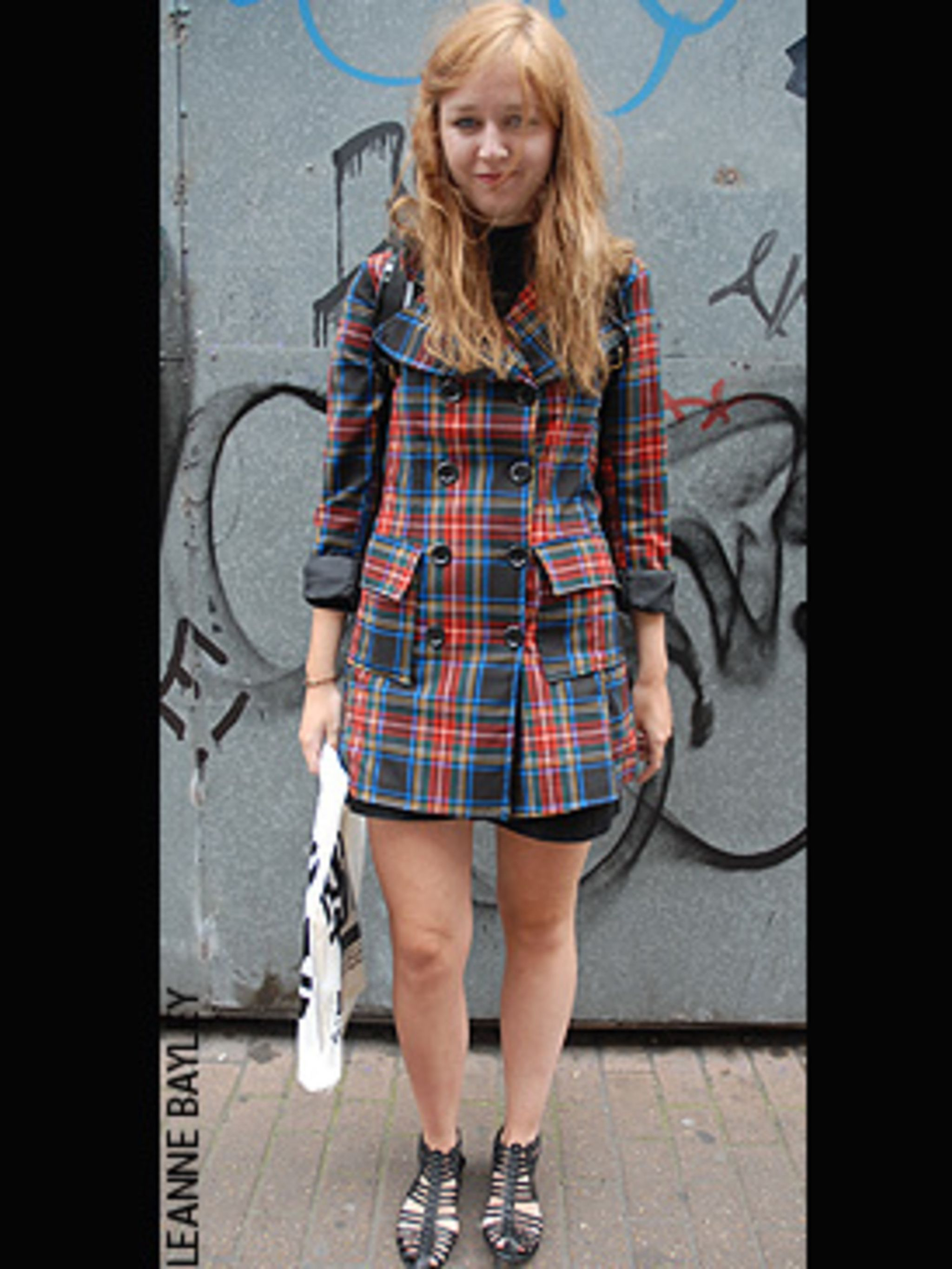 <p>Who says coats have to be boring? Add an instant lift to your black autumn wardrobe by investing a cool tartan trench. We love the way that Issie has rolled the cuffs of hers and teamed it with a roll-neck and bare legs - ever ready for the unpredictab