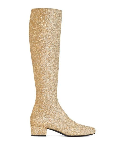 "<p><a href=""http://www.ysl.com/gb/shop-product/women/shoes-babies-boots-babies-40-central-cut-boot-in-gold-metallic-glitter-fabric_cod44696204lm.html#dept=gift_women_"" target=""_blank"">Saint Laurent</a> knee length boot, £795.</p>"