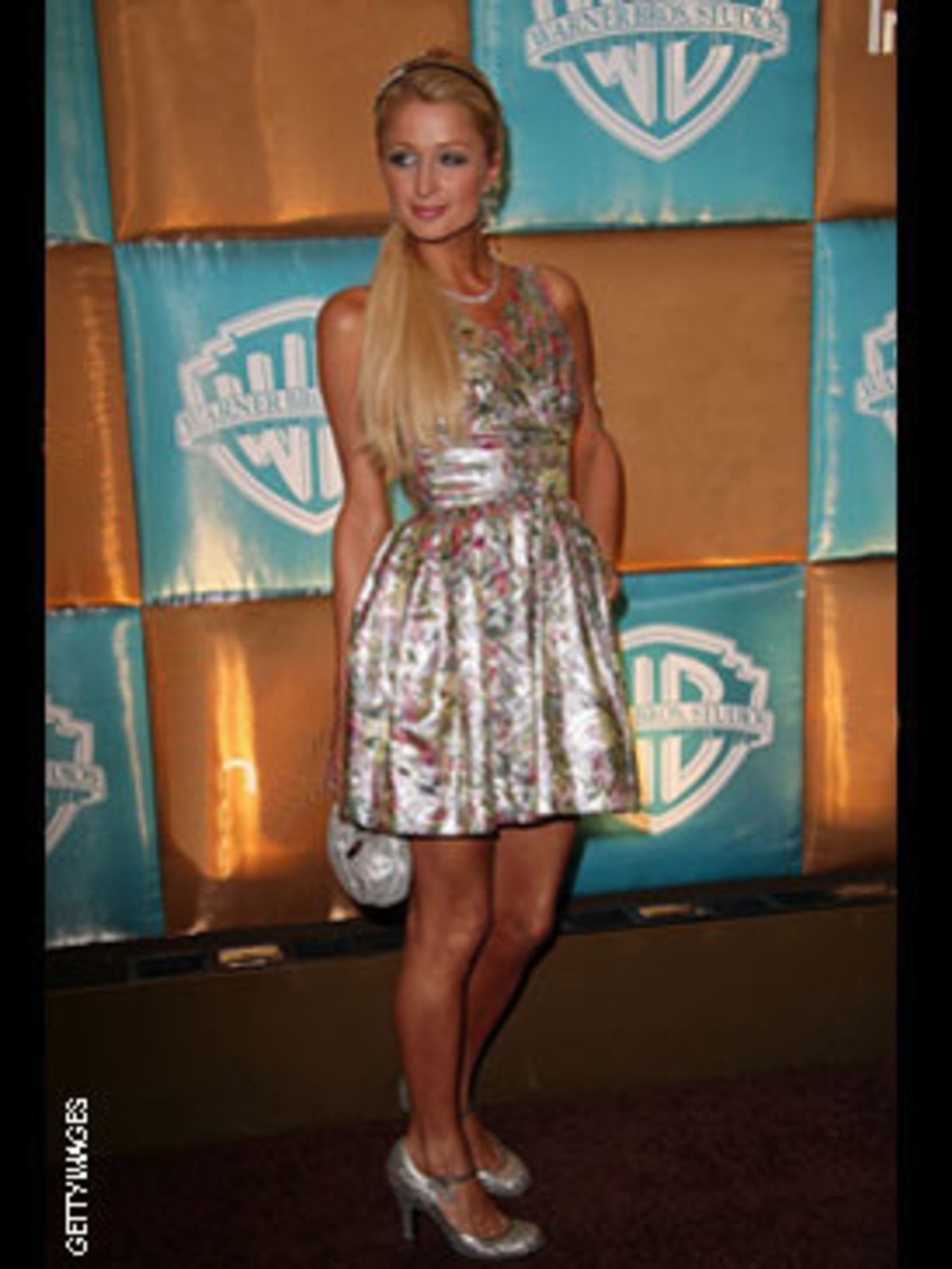 <p>She may be an heiress but she still loves the high street - this frock is H&M!</p>