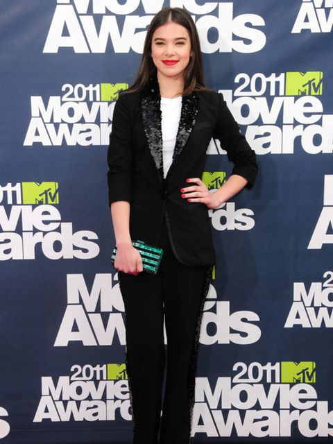 """<p>Hailee Steinfeld look on the red carpet at the MTV Awards is a <a href=""""http://www.elleuk.com/catwalk/collections/louis-vuitton/spring-summer-2011"""">Louis Vutton</a> Black Suit with a sequin collar and adding a touch of colour with an Edie Parker clutch"""