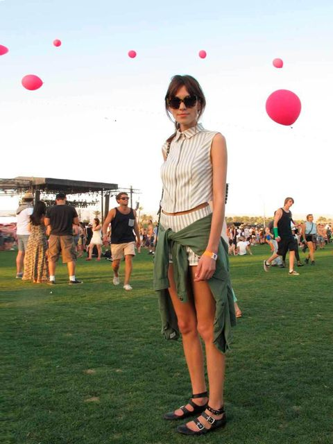 """<p><a href=""""http://www.elleuk.com/star-style/celebrity-style-files/alexa-chung-s-style-file"""">Alexa Chung</a> wears a Philosophy dress and Karen Walker sunglasses to Coachella 2013.</p>"""