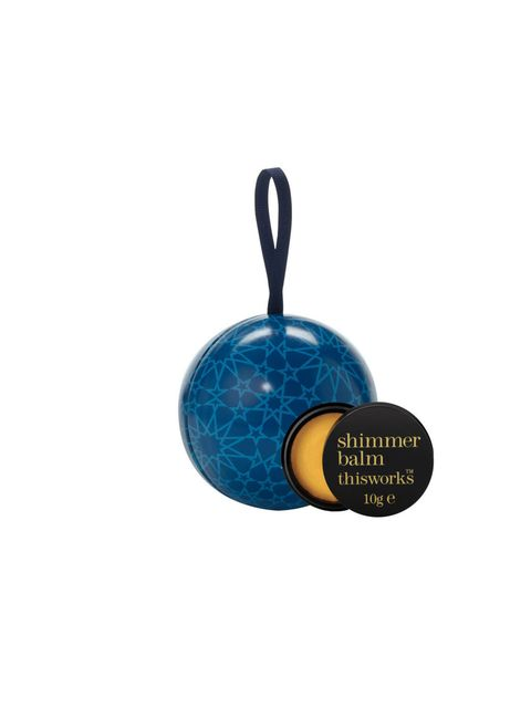 """<p><a href=""""http://www.thisworks.com/gifts-1/christmas-gifts/beauty-ball-glamour-glitter-gold-shimmer-balm.html"""">This Works Beauty Ball, £10</a></p>"""