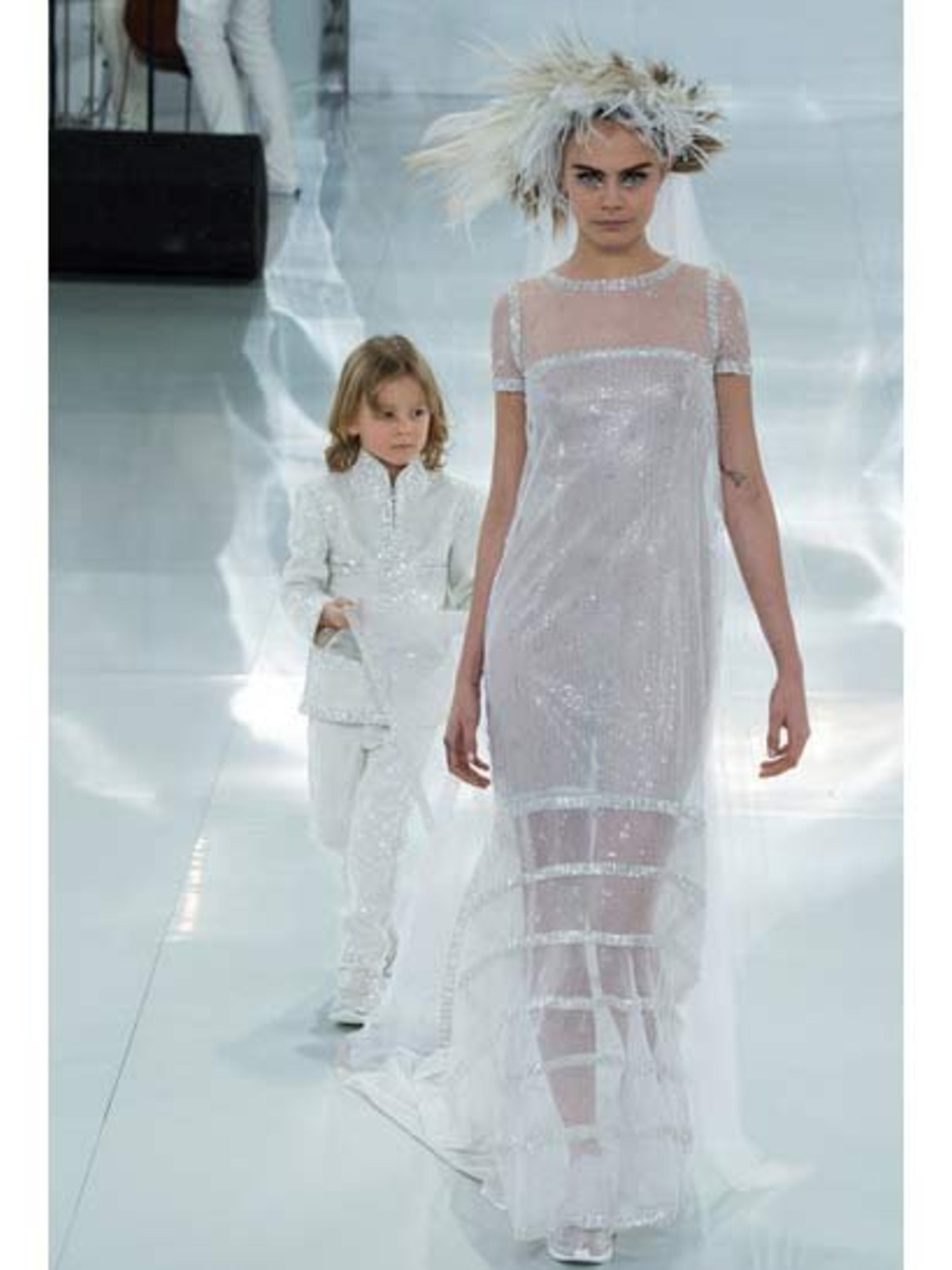 <p>Getting married in Chanel: cool. Getting married in Chanel trainers: even cooler.By Chanel.</p>