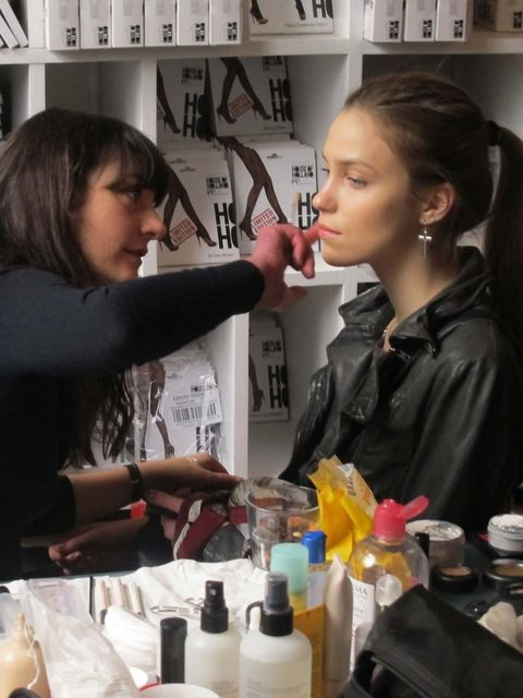 <p>A model in make-up before the House of Holland show</p>