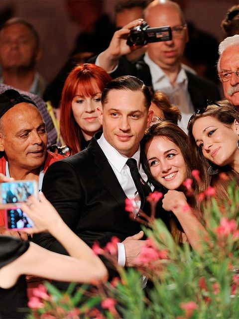 """<p><a href=""""http://www.elleuk.com/star-style/red-carpet/best-dressed-70th-venice-international-film-festival-2013"""">Tom Hardy</a> is God's gift to YouTube (and we should know). We've watched him rap with his baby (double-swoon) confess his sins to Jonathan"""