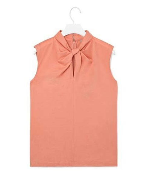 "<p>A loose-fit for a relaxed silhouette, it has a stand-up collar and hidden zip fastening on the back. £35 at <a href=""http://www.cosstores.com/gb/Shop/Women/Tops/Knot_neckline_top/46885-15098887.1"">COS</a>.</p>"
