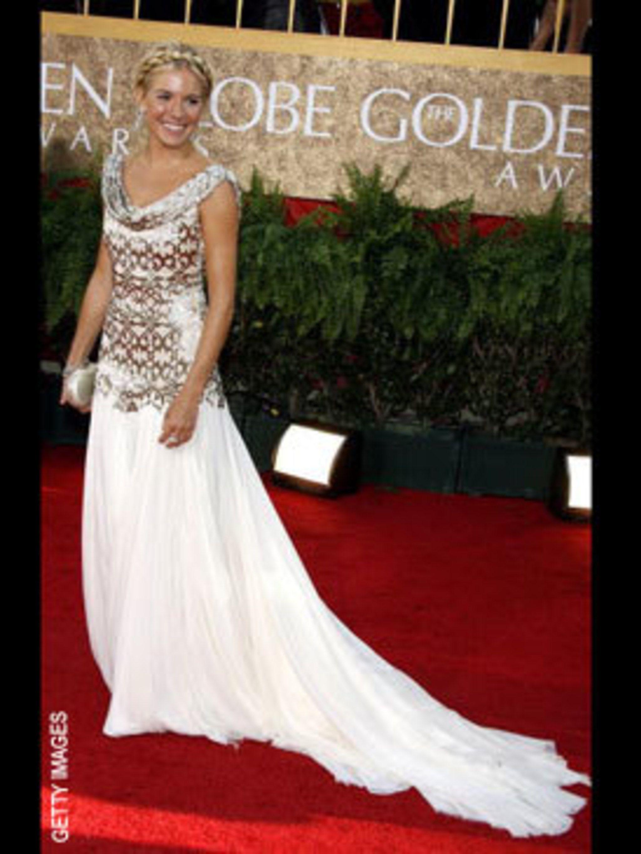 <p>Sienna Miller in a sparkling Marchesa gown</p>