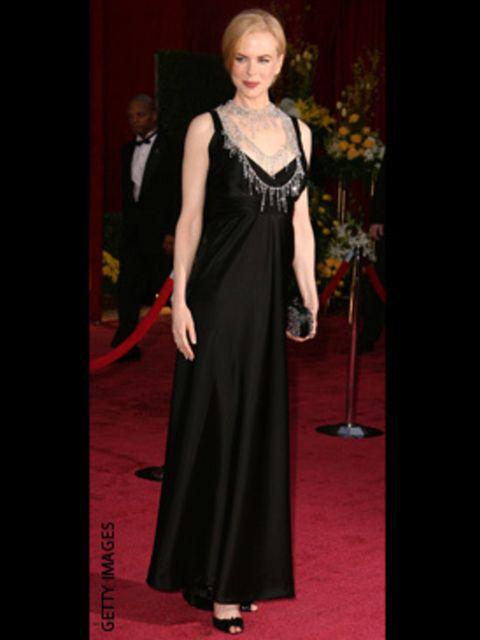 <p>Wearing a Balenciaga dress with a L'Wren Scott necklace</p>