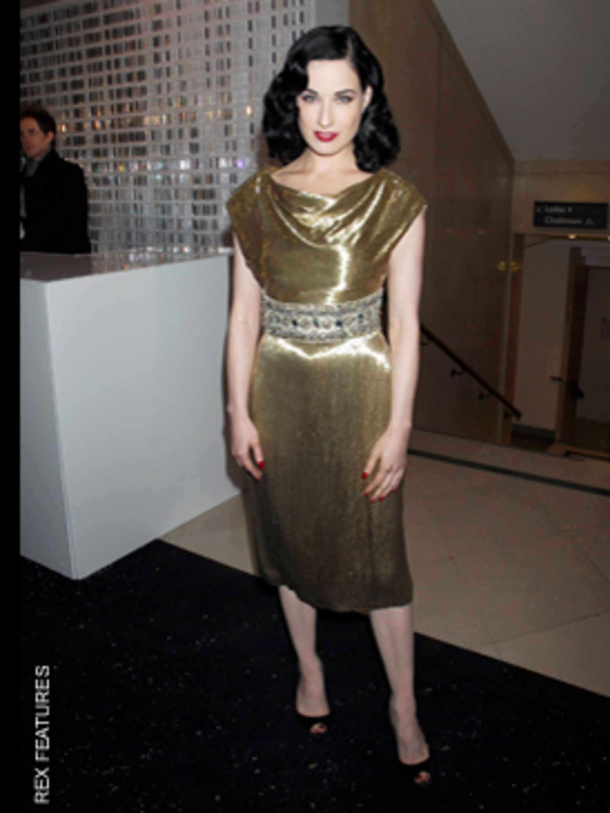 <p>Dazzling in a Marchesa dress and Christian Louboutin shoes</p>