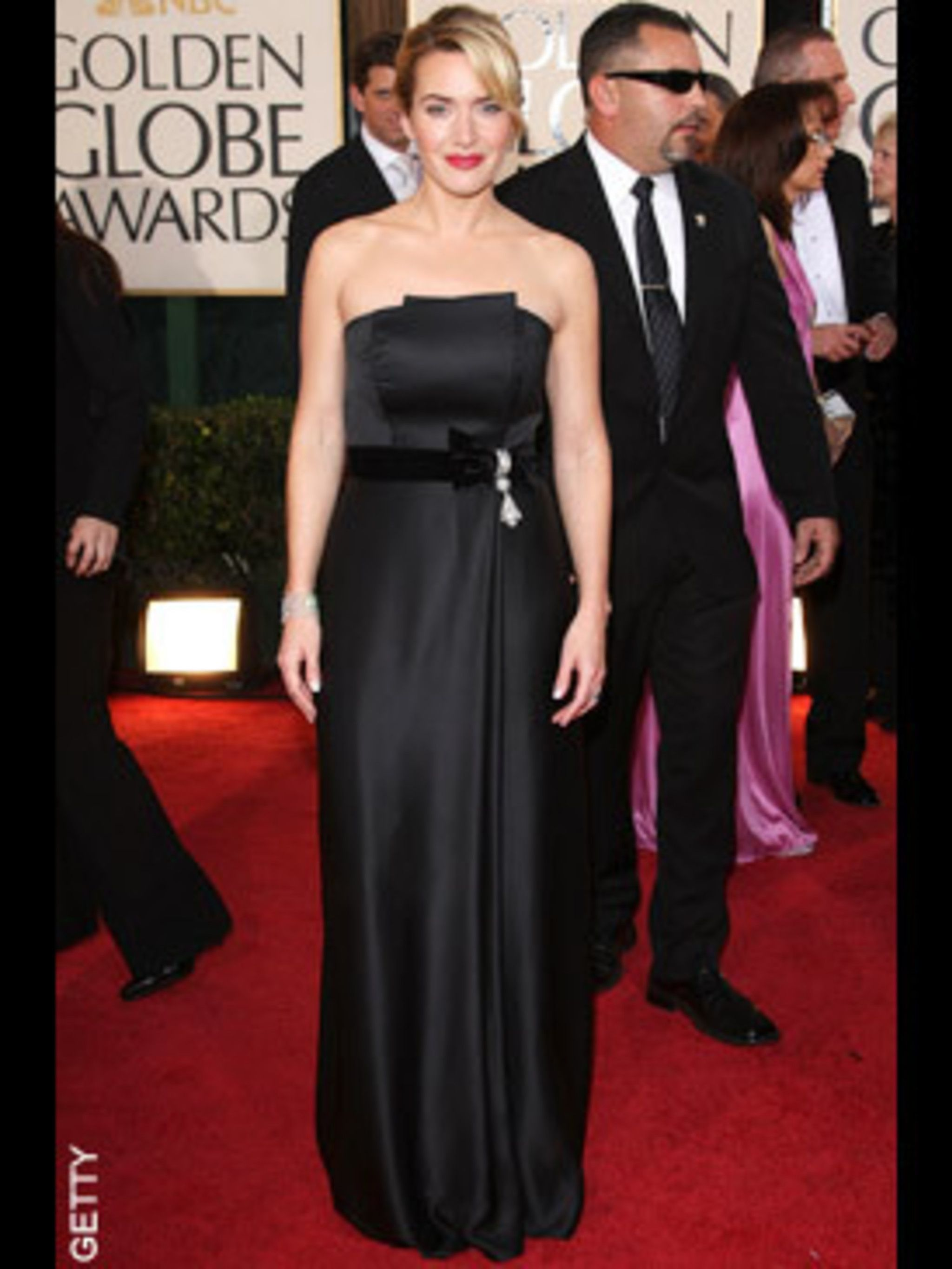 <p>Kate Winslet picked up two awards looking chic and sophisticated in Yves Saint Laurent</p>