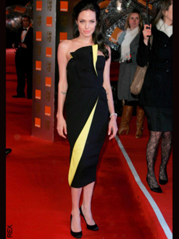 <p>Angelina Jolie wearing an Armani Prive dress with Christian Louboutin shoes</p>