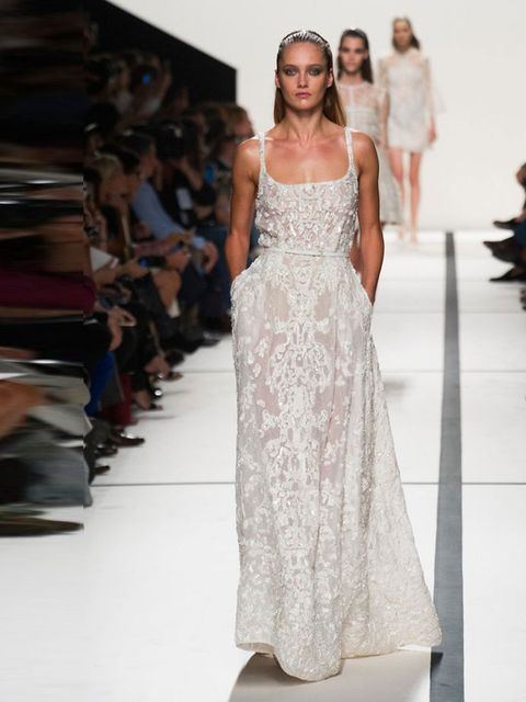"""<p><a href=""""http://www.elleuk.com/catwalk/designer-a-z/elie-saab/spring-summer-2014/collection"""">Elie Saab</a>, Spring/ Summer 2014.</p><p>Ornate embroidery combined with ultra-flattering shimmer and a characteristically Saab use of transparency, ready to"""