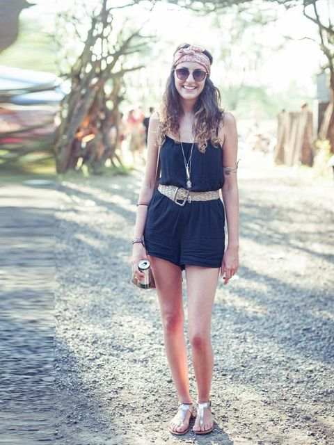 <p>Daisy McLeod wears Topshop playsuit, Next sandals, Mink Pink sunglasses, Topshop necklace, Great grandmother's headscarf and bag with vintage belt.</p>