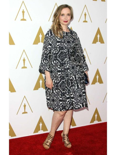 <p>Julie Delpy wears a matching print dress and dress coat by Escada to attend the 86th Annual Academy Awards Nominee Luncheon.</p>